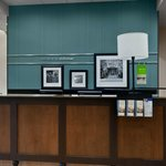 The front desk at the Hampton Inn & Suites Tampa Northwest Oldsmar