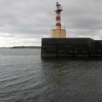 Lighthouse at the entrance to Amble Harbour