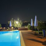 Swimming pool at night with view of San Gimignano