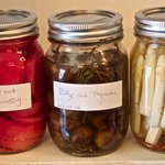 Numerous pickled items.
