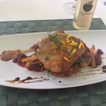 Confit of Duck served over Potato Rosti, Spinach and Goats Cheese, with Poached Pear