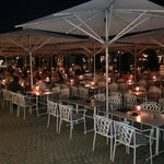 Night time view of outside seating.