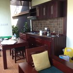 1br pool villa lounge and kitchen