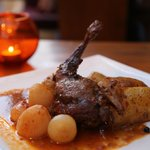 Marinated Rabbit in red wine and cooked with mini onions, potatoes  and garlic