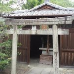 Just past the entrance, a small shrine