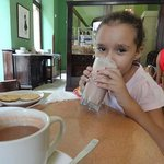 My cousin enjoying her milk shake and my traditional