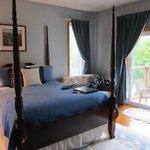 bedroom on main floor with balcony overlooking lake