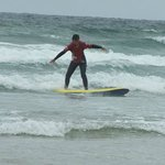 Alison surfing