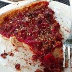 Carne pizza slice
