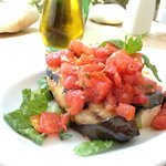 Eggplant Aubergine stuffed with feta and served with tomatoes