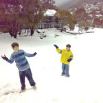 children playing in snow outside Snowbound Chalets