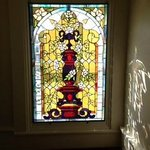 Stained glass window in hallway of College Hill B&B