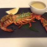 Half lobster marinated and grilled served with Moulee sauce from Kerala