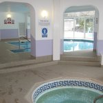 Indoor pool with view of the outdoor pool.