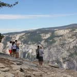 Husband, kids & our guide, Gregg atop Sentinel Dome