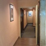 Upper floor halls aren't marbled, but instead peach walls, laminate flooring & dark carpet
