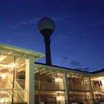 the hotel and golf ball water tower at night.