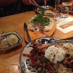 Lamb pizza, chicken kebab, calamari in background