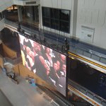 Streaming on the Newseum's huge screen - President Obama giving a speech a couple of blocks away