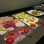 Free breakfast buffet from 8 am to 9:30. Different to have what we Americans consider lunch meat