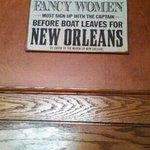 interesting ladies room sign