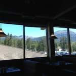 Windows on the other side of this second-story restaurant reveal a beautiful view of the mountai