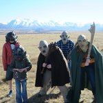 A pack of orcs moves across the plains