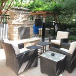 Outdoor fireplace seating area- nice