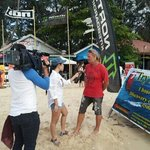 Bob is interviewed by a local TV station about practicing kiteboarding safely at his school. Wel