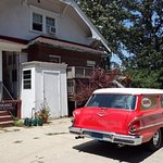 Rear of the house with classic Chevy