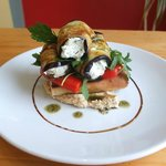 Aubergine rolls filled with za'tar and cream cheese served on bruchetta