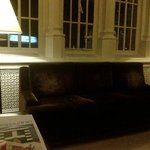 Comfy couch in front lobby where there is free wi-fi