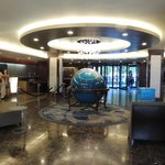 Lobby: Check in Desk on the Left, Main Entrance Behind the Globe