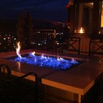fire pit on the rooftop restaurant at dusk