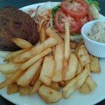 Veggie burger, chips, and 'Vegan goddess dressing'