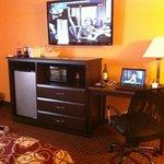 Mocrowave, fridge, dresser, desk, and nice big TV