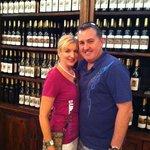 A couple's photo among the vino!