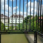 Balkon z kratami. Widok z pokoju Bara Junior ** na hotel Bara ***