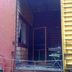 Balacony area between rooms in a box car