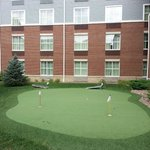 "Putting green, beanbag toss, and ""ladder ball"" (?) games in the courtyard."