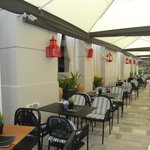 Outdoor seating area of 3Sixty in Nafplio