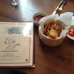 Menu, salsa, chips and pickled carrots