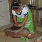 Heliadora Saqui, demenstrating chocolate making at the Mayan Museum. You will get otdo this.
