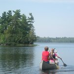 kids canoeing to Ludlow's camping island