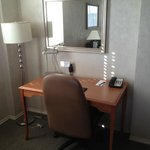 cheap looking desk and lampshade that was not straight