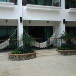Each room has a patio or balcony with a hammock