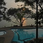 sunset over the lake and pool