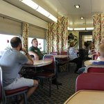 Museum tour guide Ed Schwab (with badge) talks about the dining car.