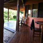 Porch, outdoor shower and dining and hammock area