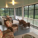 Screen porch overlooking pool, great spot to read a book or have a glass of wine.